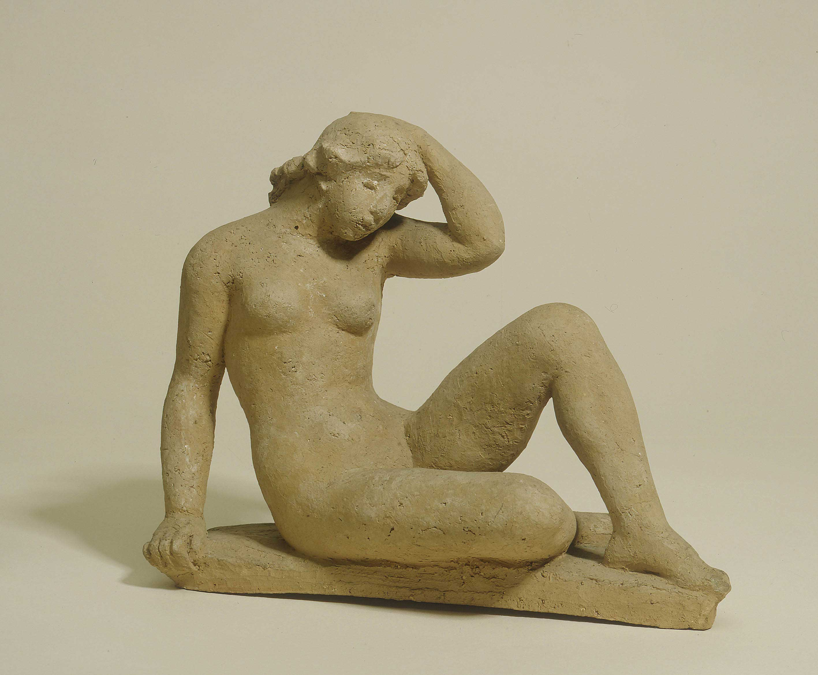 Aristide  Maillol - Seated female nude with her left hand on her head
