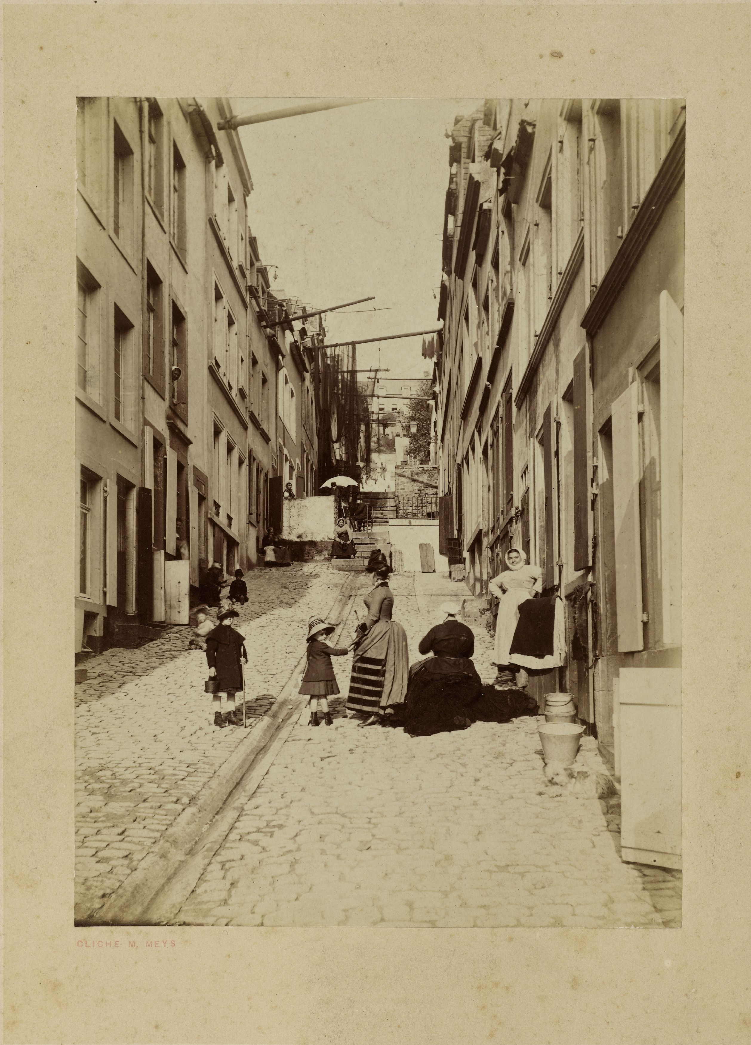 The painter Louis-Robert Carrier-Belleuse (?) painting in the open air – street