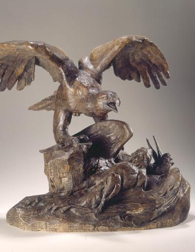 Aigle tenant un héron