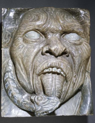 Masque grotesque, fragment du revers